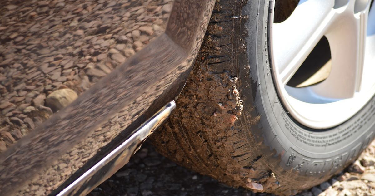 Close-up of mud on a car's tire