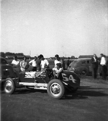 a vintage sprint car and driver