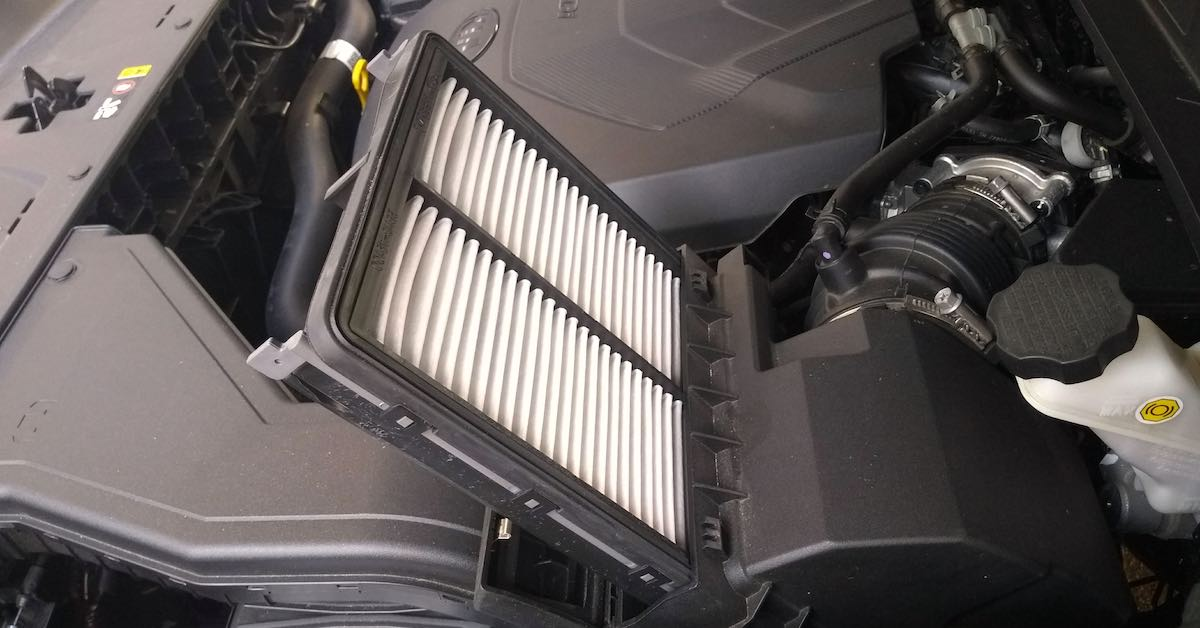 Close-up of a panel engine air filter under the hood of a car