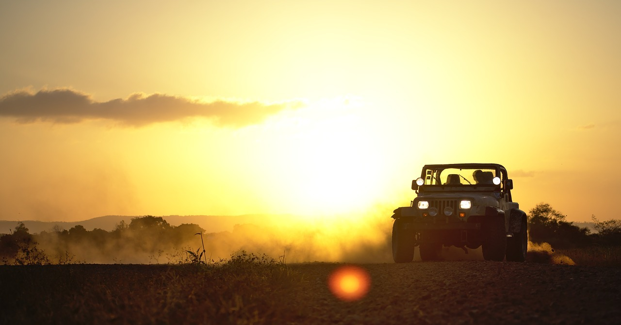 Jeep against a landscape at twilight