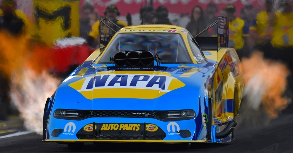 A NAPA-sponsored funny car with a blurry background