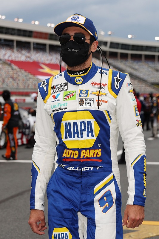 CONCORD, NORTH CAROLINA - MAY 24: Chase Elliott, driver of the #9 NAPA Auto Parts Chevrolet, walks the grid during qualifying for the NASCAR Cup Series Coca-Cola 600 at Charlotte Motor Speedway on May 24, 2020 in Concord, North Carolina. (Photo by Chris Graythen/Getty Images)
