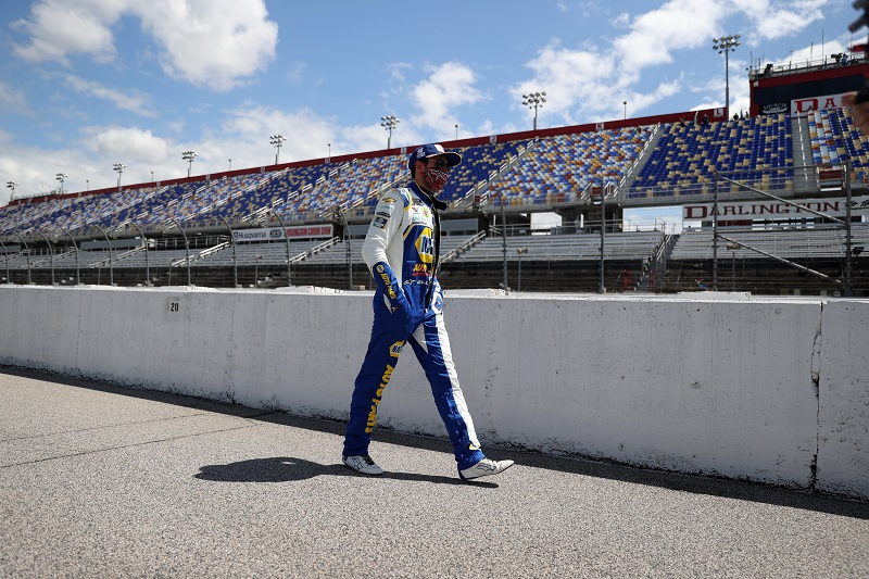 DARLINGTON, SOUTH CAROLINA - MAY 17: Chase Elliott, driver of the #9 NAPA Auto Parts Chevrolet, walks down the grid during the NASCAR Cup Series The Real Heroes 400 at Darlington Raceway on May 17, 2020 in Darlington, South Carolina. (Photo by Chris Graythen/Getty Images)