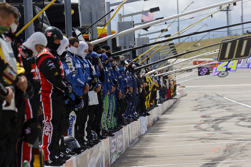 HAMPTON, GEORGIA - JUNE 07: Crew members pause and stand on pit wall for a moment of listening in reflection of recent social unrest prior to the NASCAR Cup Series Folds of Honor QuikTrip 500 at Atlanta Motor Speedway on June 07, 2020 in Hampton, Georgia. (Photo by Chris Graythen/Getty Images)