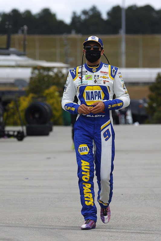 HAMPTON, GEORGIA - JUNE 07: Chase Elliott, driver of the #9 NAPA Auto Parts Chevrolet, walks the grid prior to the NASCAR Cup Series Folds of Honor QuikTrip 500 at Atlanta Motor Speedway on June 07, 2020 in Hampton, Georgia. (Photo by Chris Graythen/Getty Images)