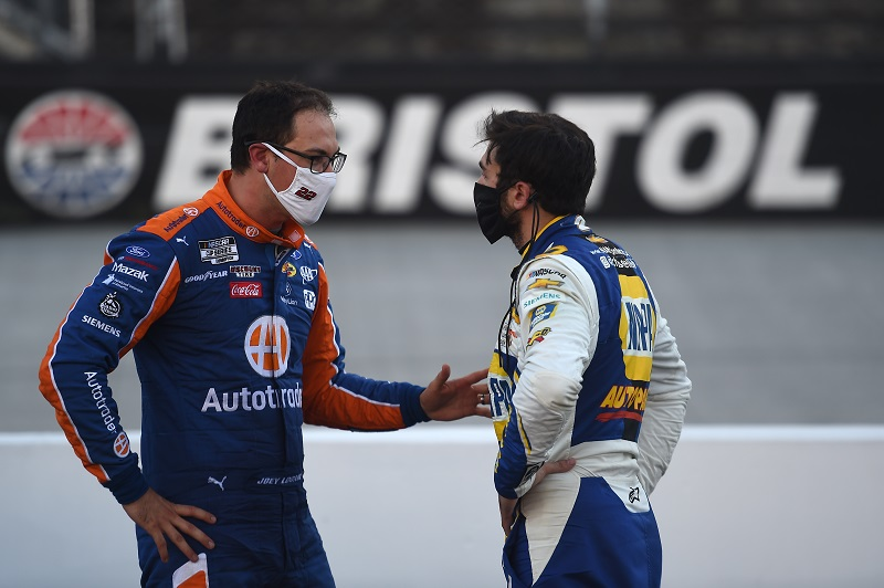 BRISTOL, TENNESSEE - MAY 31: Joey Logano, driver of the #22 Autotrader Ford, talks with Chase Elliott, driver of the #9 NAPA Auto Parts Chevrolet, after the NASCAR Cup Series Food City presents the Supermarket Heroes 500 at Bristol Motor Speedway on May 31, 2020 in Bristol, Tennessee. (Photo by Jared C. Tilton/Getty Images)