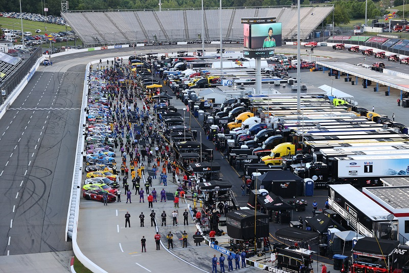 MARTINSVILLE, VIRGINIA - JUNE 10: Drivers and crew stand during the national anthem to start the NASCAR Cup Series Blue-Emu Maximum Pain Relief 500 at Martinsville Speedway on June 10, 2020 in Martinsville, Virginia. (Photo by Rob Carr/Getty Images)