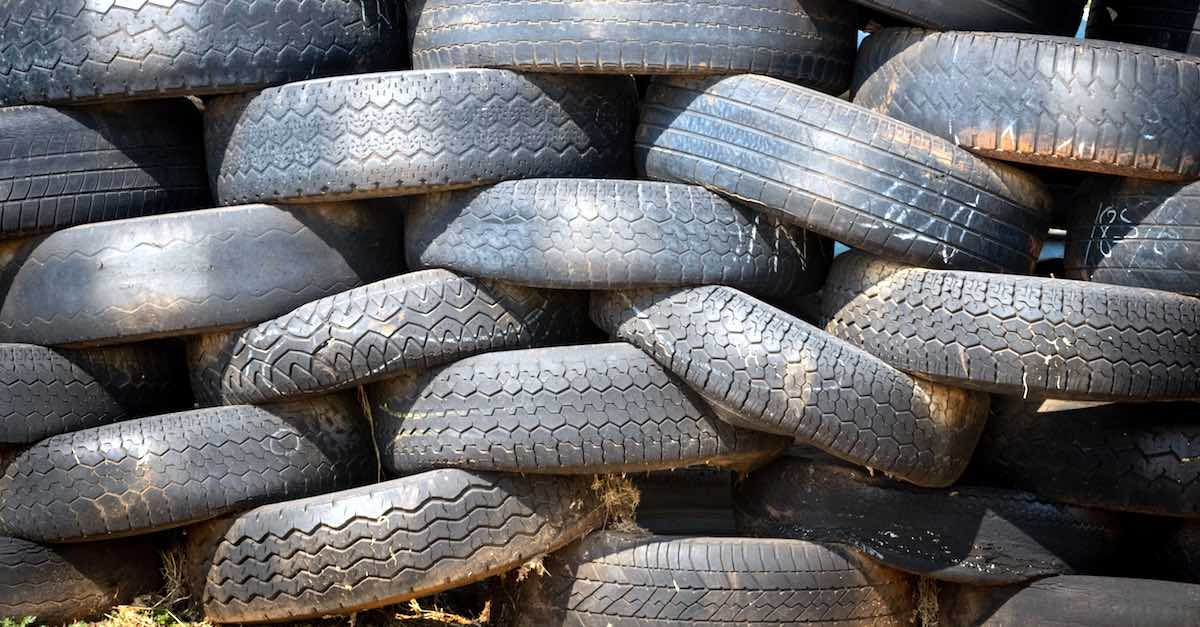 Stack of old, dusty tires