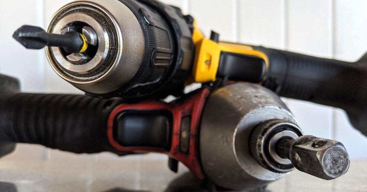 Power drill leaning on an impact driver