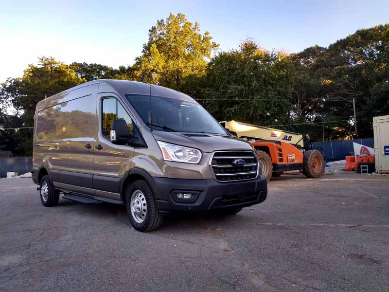 2020 Ford Transit at a construction site.