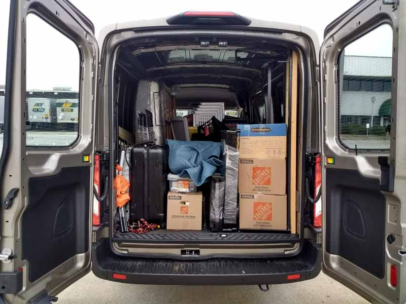 2020 Ford Transit cargo area full of furniture.