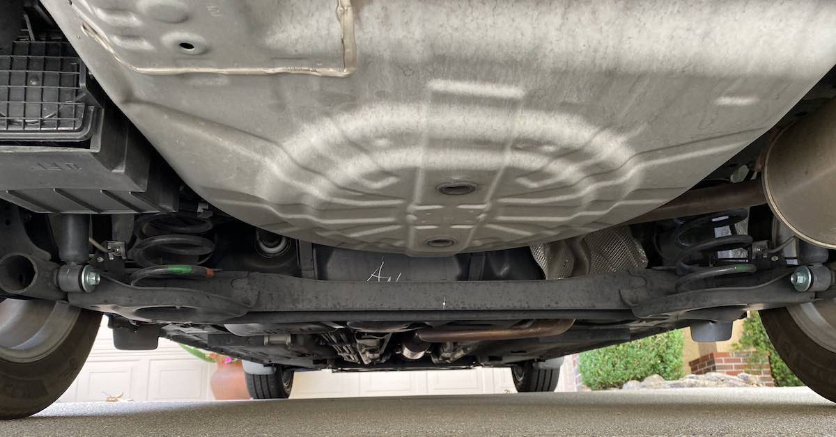 The clean, rust-free undercarriage of a small car.
