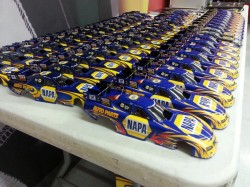 I love my job! Getting to sign my name on all these awesome collectible die cast NAPA cars for all of our great customers is an honor!