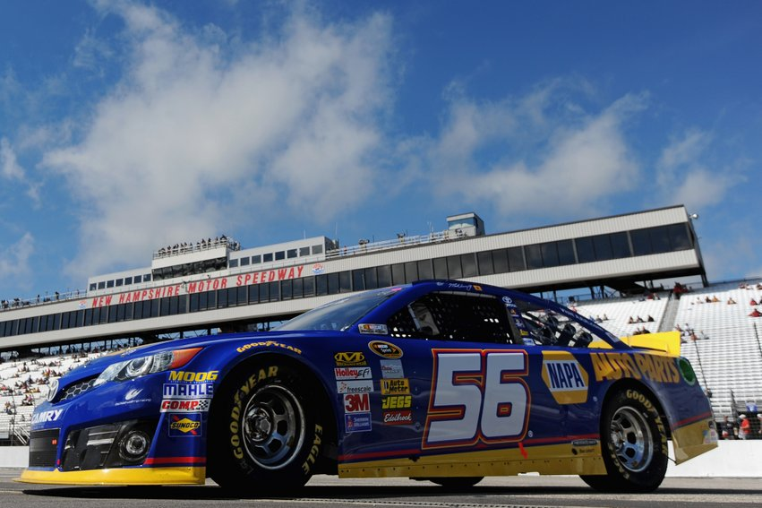Martin Truex Jr., driver of the #56 NAPA Auto Parts Toyota, drives through the garage area during practice for the NASCAR Sprint Cup Series Sylvania 300 at New Hampshire Motor Speedway