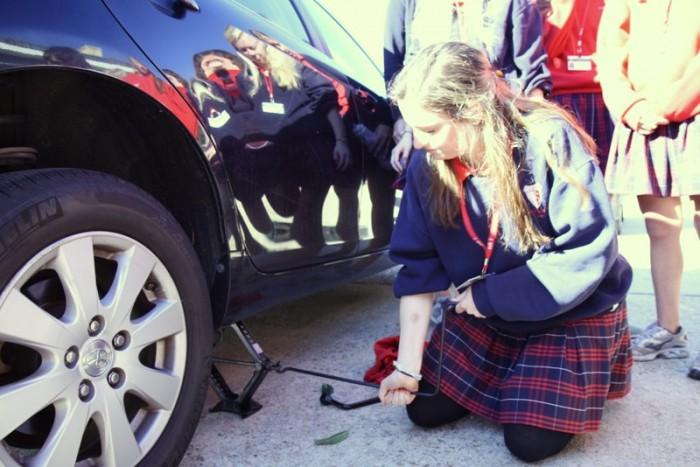 car repair, education, high school, tire change, women, girls