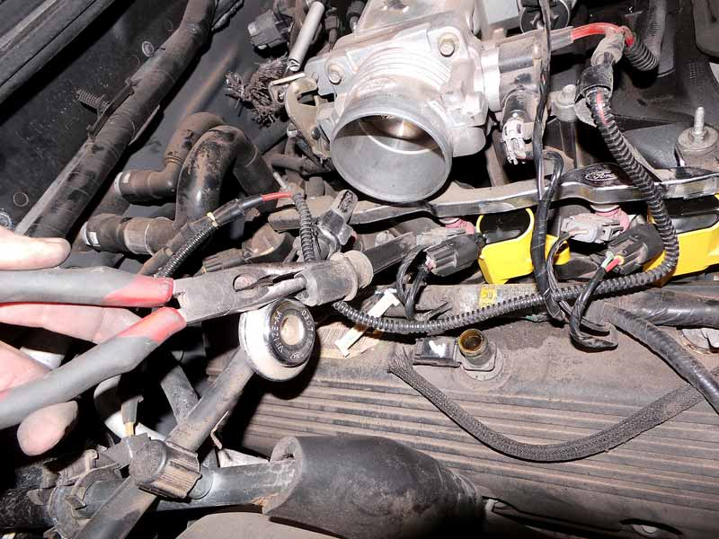 If the boot tears from the coil, use needle-nose pliers to yank the boot out.