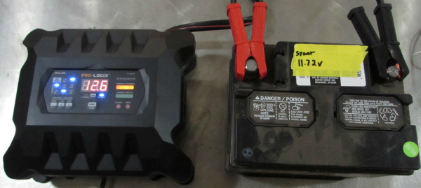 Hooking up the digital battery charger to the car battery