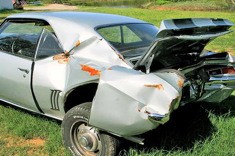 The Camaro was hit so hard that even the back seat was bent. While it might be savable, the labor involved would far exceed its value.