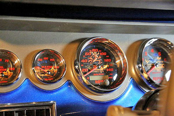 Autometer's Custom Shop built the gauges that Red Dirt Rodz designed. Tom Kelly of Crazy Car Painters hand-painted the Road Runner and Coyote desert scene on each gauge face.