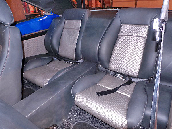 The custom bucket seats are made by ProCar. The Red Dirt Rodz crew fabricated the panels to blend the rear buckets into the body.