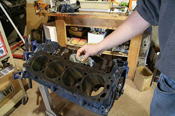 Painting an engine can be done either before assembly or after, it really does not matter. Our 302 block had been machined and is ready to assemble, so we just painted it up before assembly. The engine was wiped clean with paint thinner and then wax and grease remover.