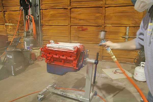 24. The silver metalflake was sprayed through the gun with a large 2.0 tip. We had to be careful not to put too much in one area. Once we had the metal flake on the motor, we sprayed the last coat of clear. Again, this was light but solid coat, covering all surfaces.
