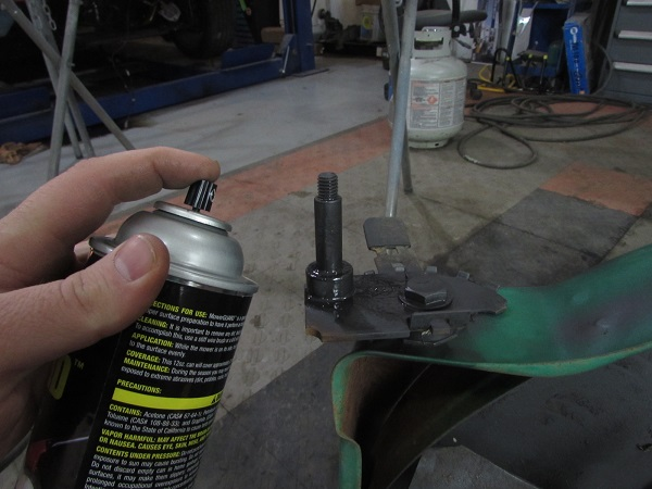 Graphite reduces friction, spraying the spindles reduces the effort to push the mower.