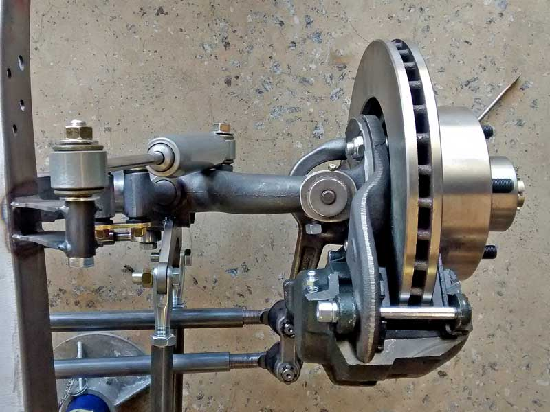 This is the updated front suspension and steering system as seen from above. The most obvious changes are the addition of a modern shock absorber and hydraulic disc brakes.