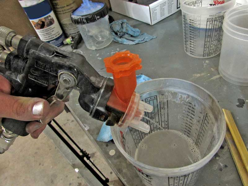 Don't worry about soaking the tips in paint thinner, it is not a good idea. Instead, just run some clean thinner though the tip until it flows clean.