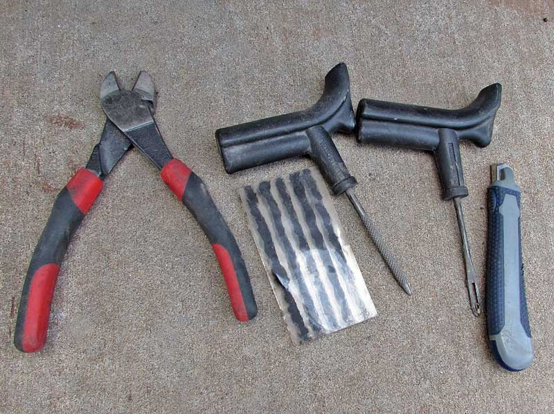These are the tools you need to install an emergency tire patch. You should keep these in your vehicle, along with a 12-volt compressor.