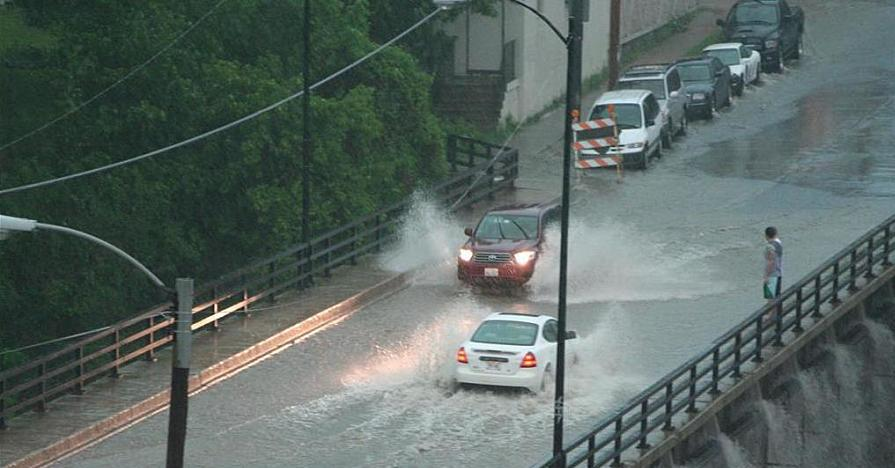 Cars driving through deep water