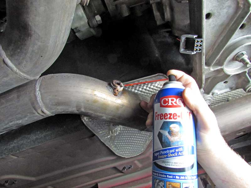 We sprayed the Freeze-Off while the exhaust was cool and left it to sit. On mildly rusted threads, this should do the trick.