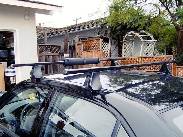 Roof rack mounted across sedan