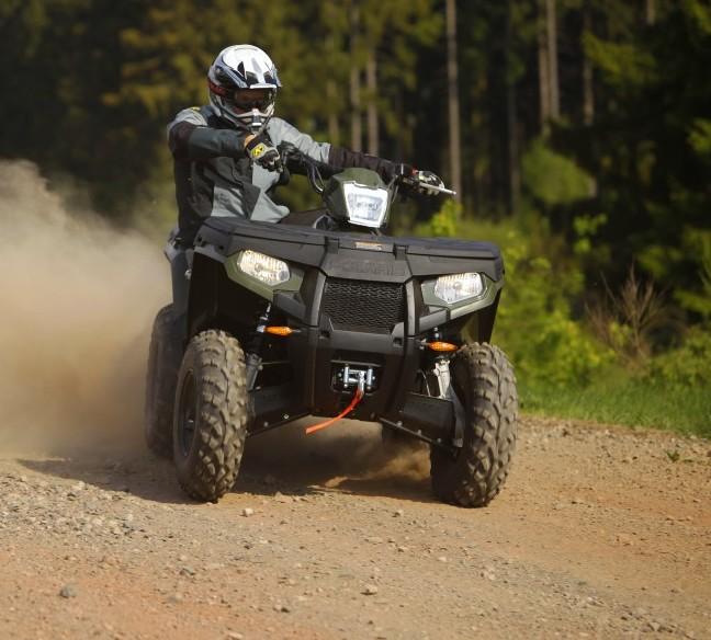 ATV drifting on sand.