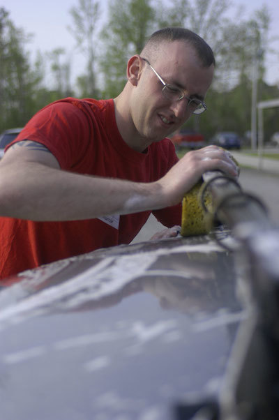 A thorough car washing by hand will help remove bug splatter.