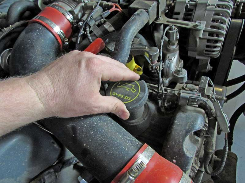 Pop the cap on the oil filler neck. You can add Sea Foam before or after an oil change.