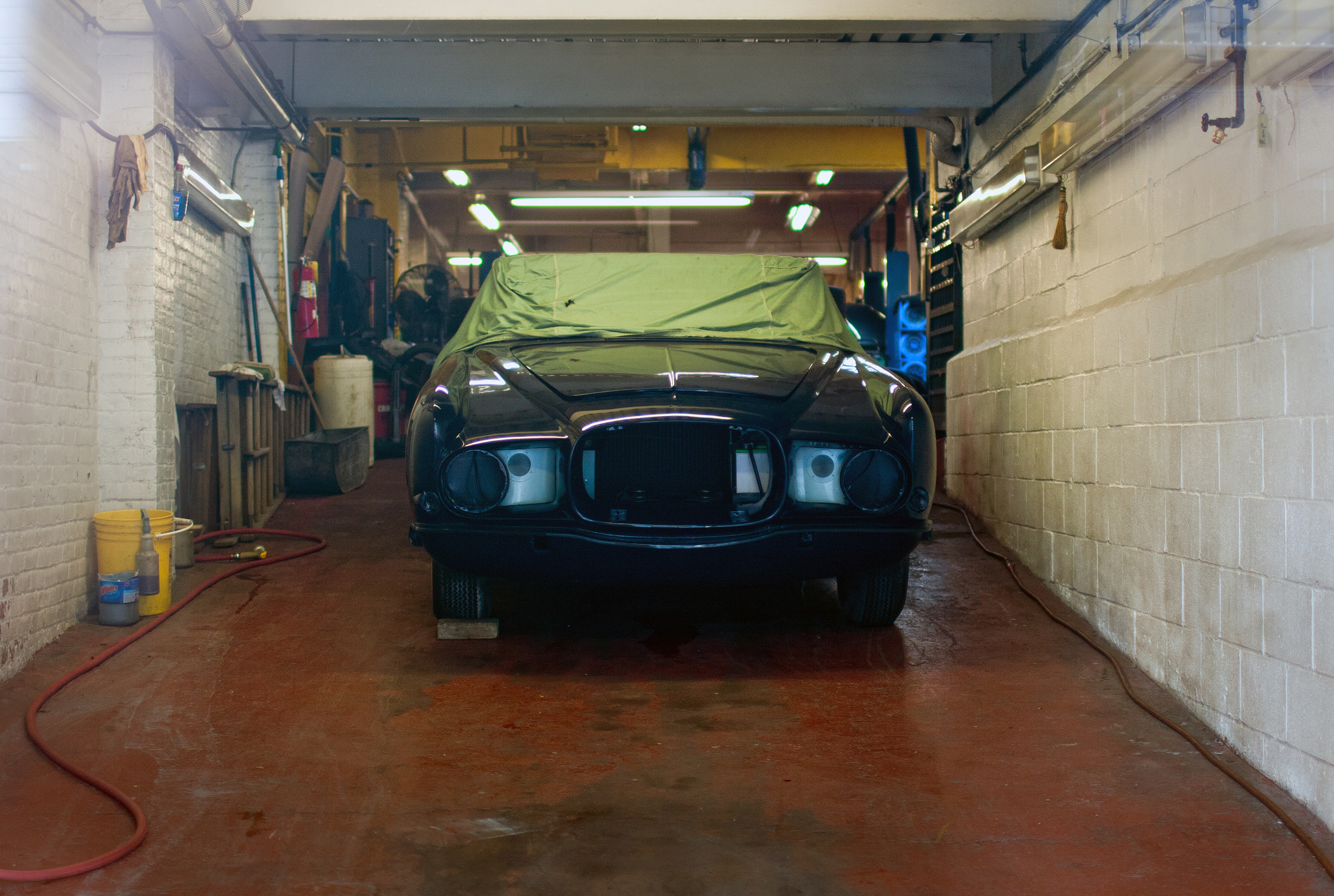 A car receiving a new paint job in the garage.