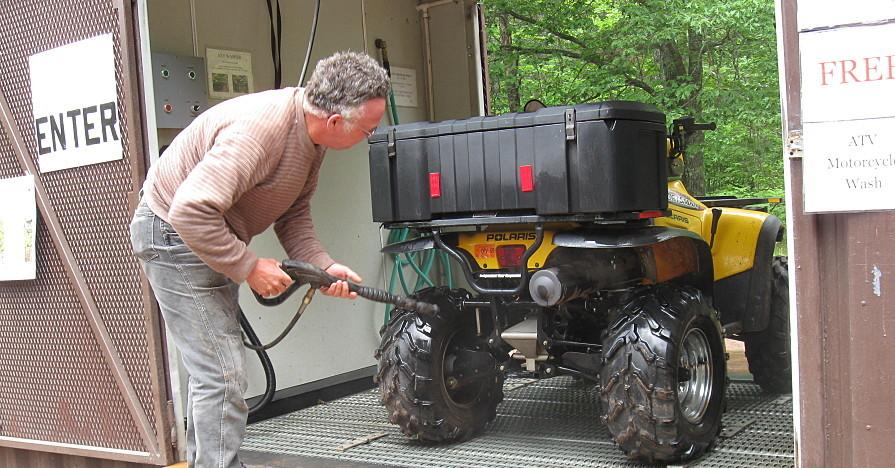 Man doing work on his ATV