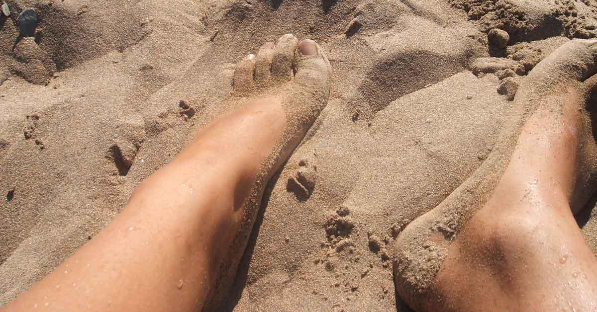 Sandy feet at the beach.
