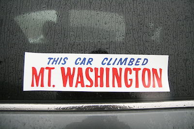 A Bumper Sticker Affixed to Glass on a Car