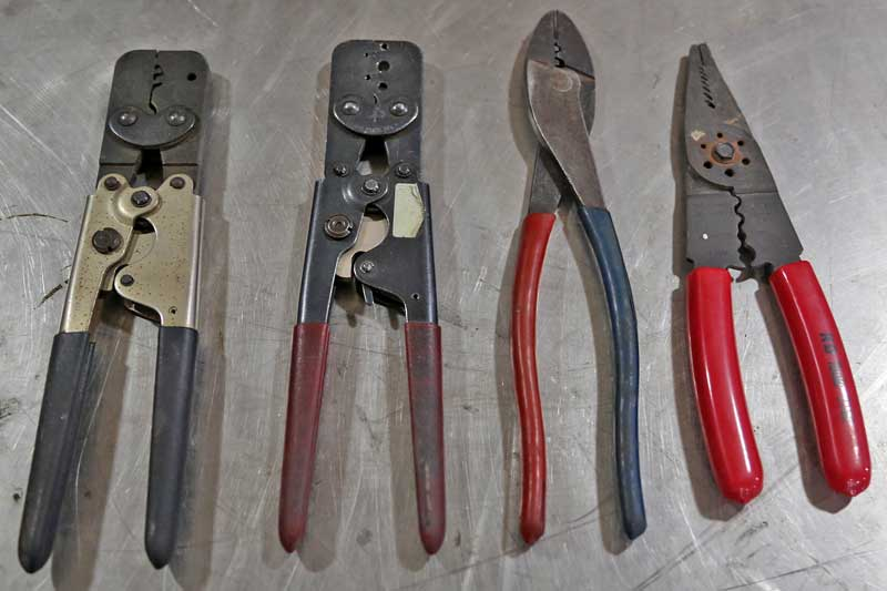 Assorted hand tools for wiring are critical to getting the job done right. From the left- Metri-pack/Weather-pack crimpers (2 sets), insulated and non-insulated crimpers, multi-use tool.