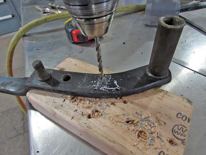 """Using a pilot bit, we drilled the new hole and then stepped up to the final size and drilled it again. The pedal is 1/4"""" thick, using two bits will make it much easier."""