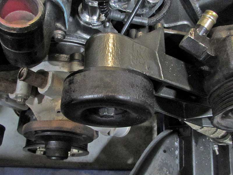 Idler pulleys (and some drive pulleys) are usually smooth, like this one on Ford 302.