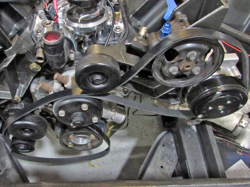 With the old belt off, the new belt was loosely wrapped around the pulleys, leaving it off one near the tensioner.
