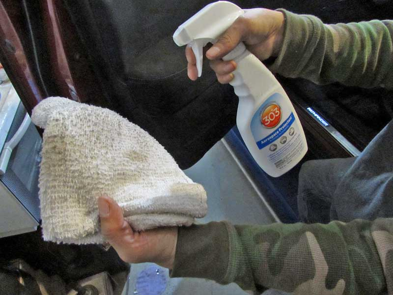 The best method is to spray the protectant onto a clean towel, this limits overspray.