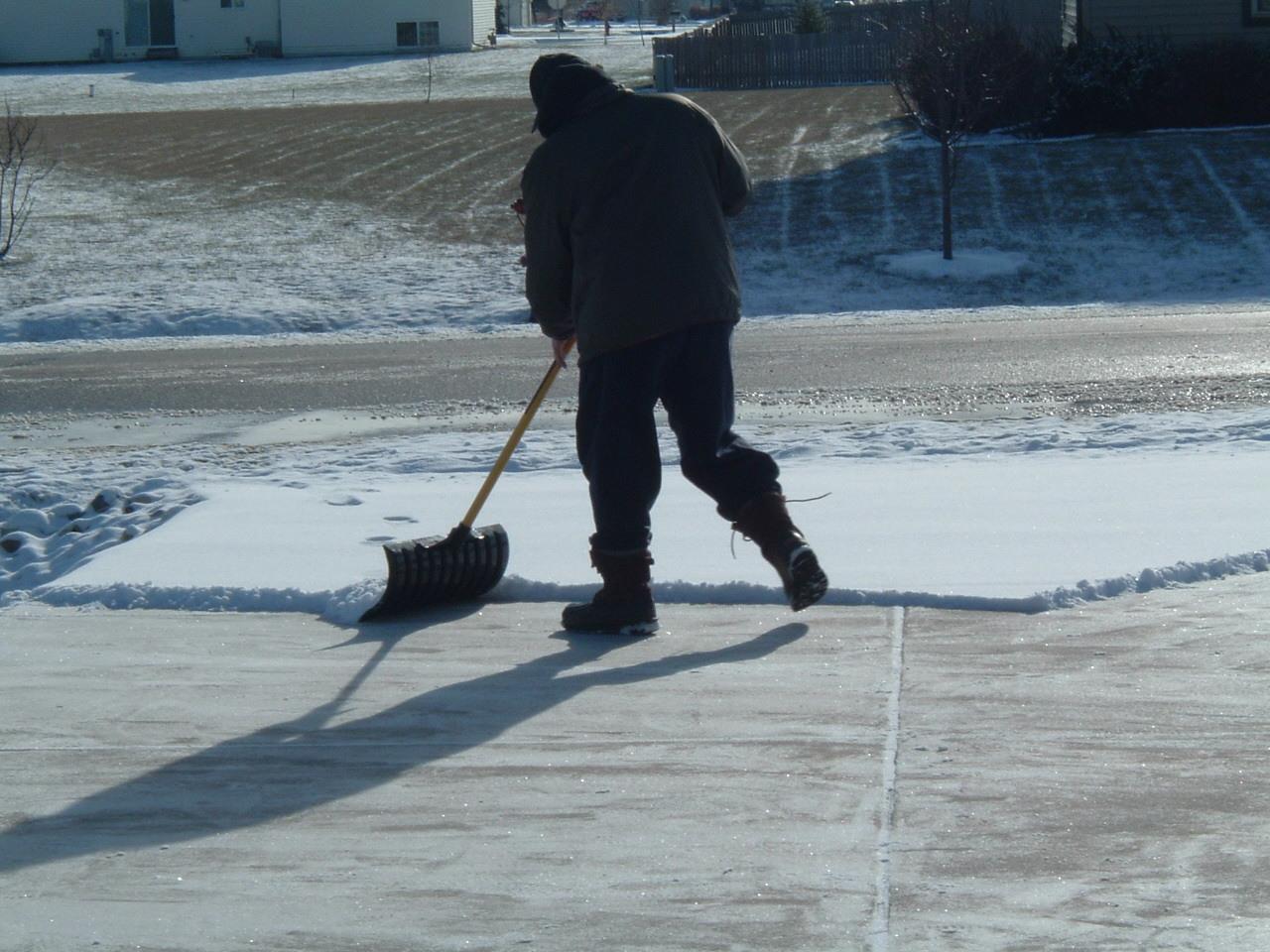 Man shoveling icy driveway