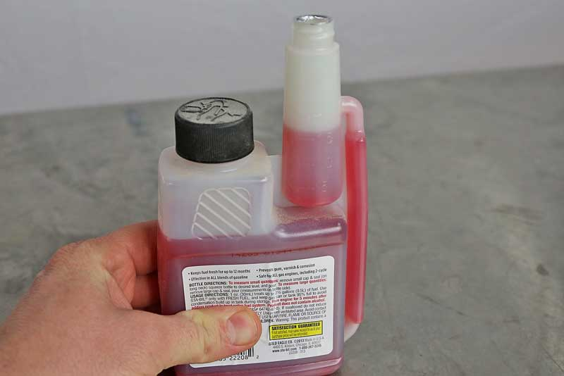 Leave the large cap tight, and then squeeze the bottle slowly to fill the dispenser to the level you need.