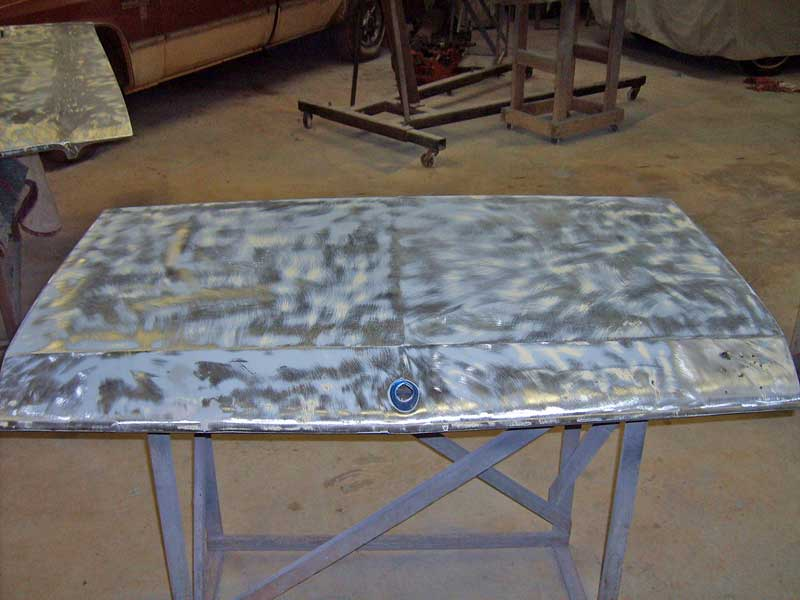 The trunk lid from a 1971 Buick GS had some rust bubbles under the trunk badge. The car was getting a repaint, so these had to be tackled immediately.