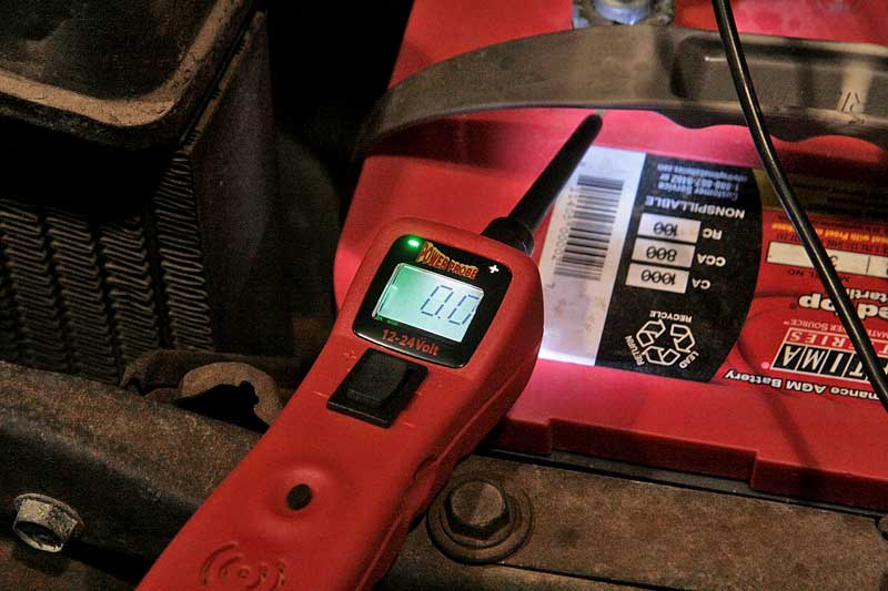 """With the Probe powered up, we placed it on the battery negative terminal. It lit the """"-"""" sign, showing a ground."""