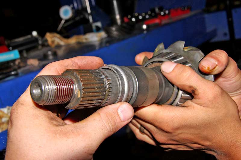 Between the pinion bearing and the housing is the crush sleeve. These only crush once and are not reusable.